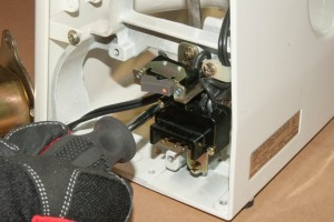 Remove the terminal block mounting screws.