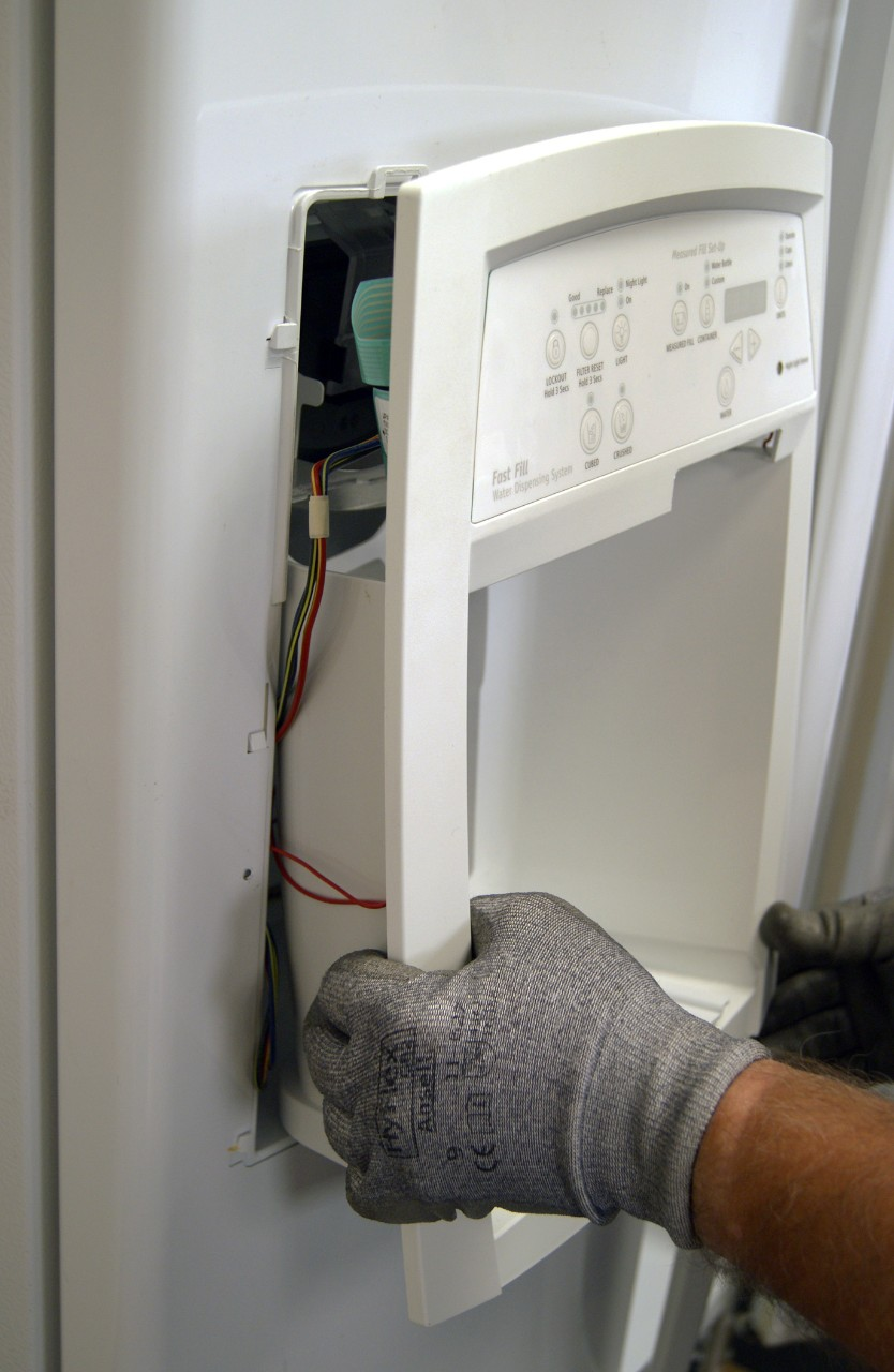 How to replace an ice dispenser motor in a side-by-side