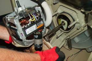 Pull the transmission and drive motor out of the washer.