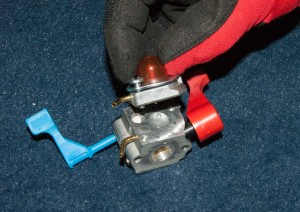PHOTO: Remove the carburetor top cover.