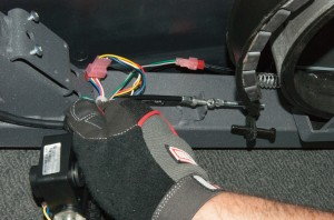 PHOTO: Slide the cable into the frame bracket.
