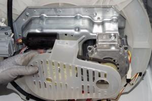 PHOTO: Remove the plastic motor cover.