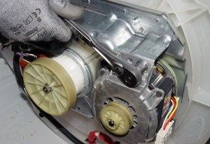 Remove the drive motor mounting bolts.