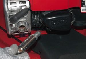 Install the new spark plug.