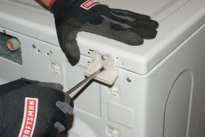 PHOTO: Reinstall the top panel rear bracket screws.