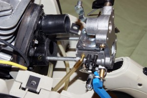 Carefully pull the carburetor forward on the mounting studs