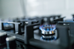 How to clean gas burners and grates on a cooktop.