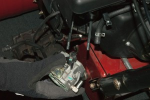 Remove the carburetor from the snowblower engine.