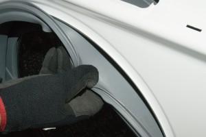 PHOTO: Reinstall the door boot.