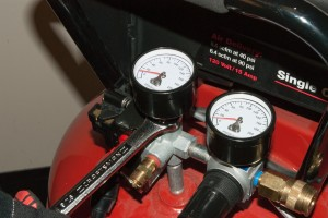 Remove the tank pressure gauge.