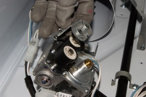 Pull the mounting bracket off the top of the valve coils.