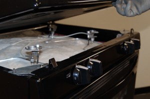 PHOTO: Lift up the front of the cooktop.