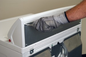 PHOTO: Remove the screws from the panel at the back of the dryer console.