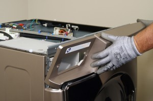 PHOTO: Pull the control panel off the washer.
