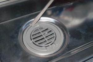 Remove the door vent grill.