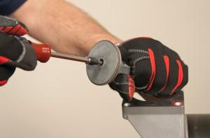 PHOTO: Reinstall the piston cap and Torx screw.