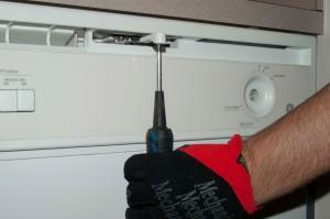 Remove the dishwasher door latch handle knob.