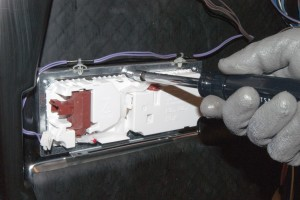 PHOTO: Install the new dishwasher detergent dispenser.