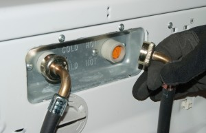 Reconnect the fill hoses to the inlet valve.