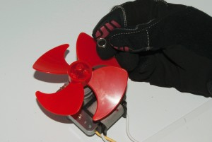 Remove the fan blade spring retainer.