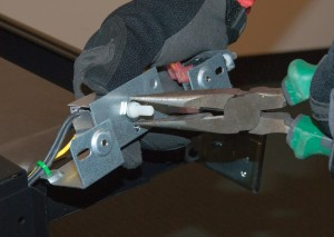 Install the new fan control switch in the bracket.