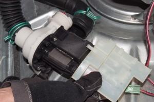 Reinstall the drain pump shield.