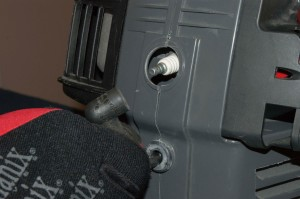 PHOTO: Disconnect the wire from the spark plug.