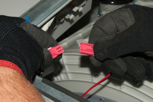 Plug in the washer drum light wire harness.