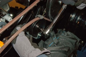 Remove the idler pulley bolt.