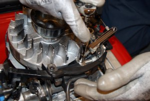 Tighten the coil mounting screws.