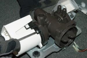 PHOTO: Remove the drain pump mounting screws.