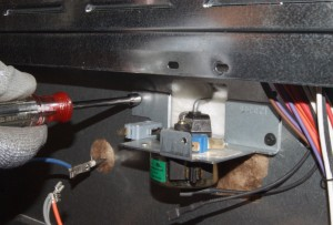 PHOTO: Remove the mounting screws.