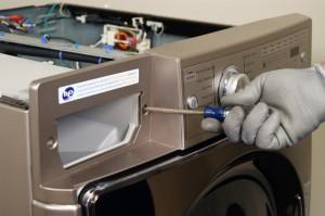 Reinstall the screws on each side of the dispenser housing.