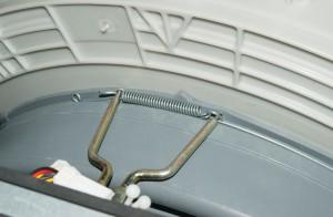 Remove the door boot inner spring clamp.