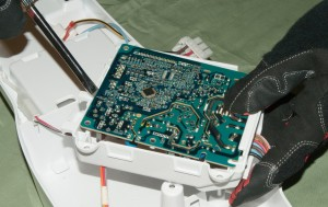 Release the circuit board from its housing.