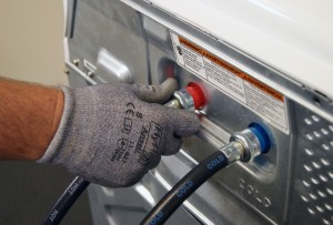 PHOTO: Disconnect the hoses from the back of the washer.