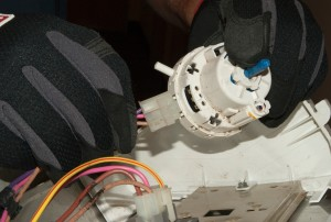 Disconnect the wire harness from the pressure switch.