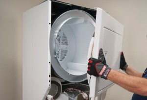 PHOTO: Reinstall the dryer front panel.
