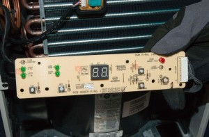 Lift the user interface control board out of the grille.