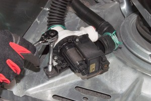 Remove the washer drain pump mounting screws.