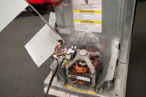 PHOTO: Pull off the motor housing cover.