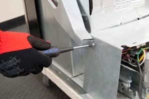 Remove the wire harness cover screw.