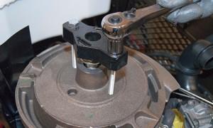 Break loose the flywheel using a puller.