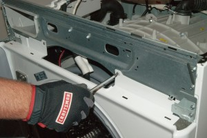 PHOTO: Remove the screws from the top of the front panel.