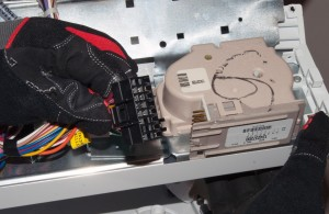 Unplug the wire harness from the washer timer.