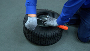 You can often fix a small hole in a riding mower tire with sealant.