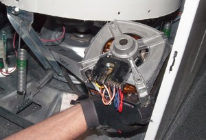 Install the new washer drive motor.
