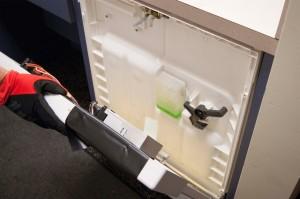 Separate the dishwasher door panels.