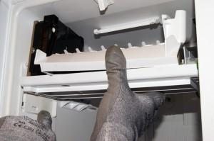 PHOTO: Slide the ice maker onto its rails.