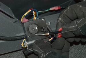 Slide the cable into the motor housing.